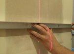 Шаг 3 - обозначение на стене точек монтажа розеток