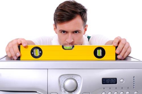 Строительный уровень на стиральной машине