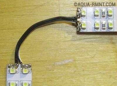 Два отрезка ленты, спаянные с помощью гибкого провода